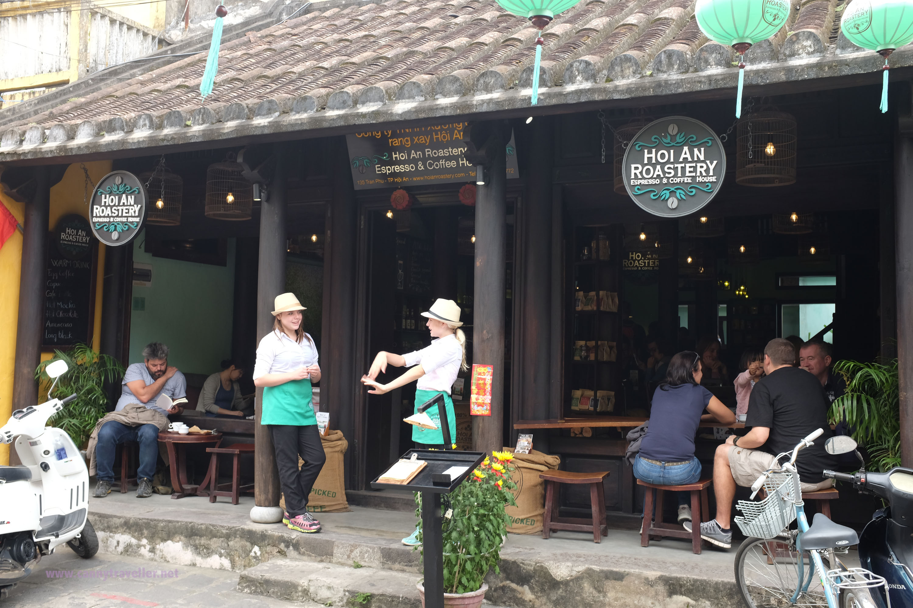 Coffee shop in the main shopping street, Hoi An, Vietnam